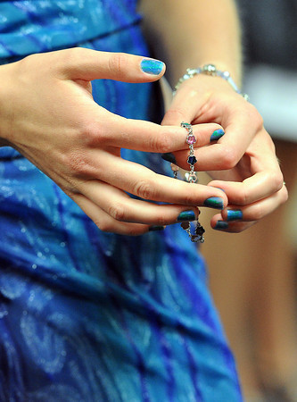 Holly Rhoads of Fort Collins, 18, sports blue nail polish to match her dress Wednesday during the Larimer County Fair 4-H Fashion Revue.
