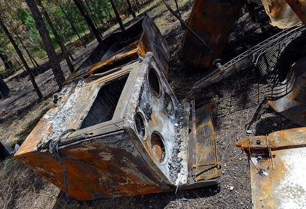 Recent rains have rusted charred metal debris like this kitchen stove from a home that was destroyed off Davis Ranch Road in the High Park fire area.