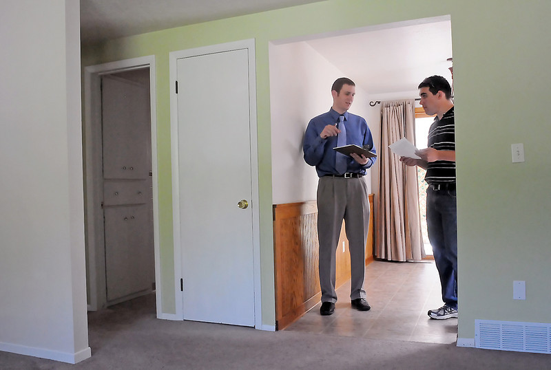 The Group, Inc. broker associate/partner Mark Moran, left, shows a home to Ryan Deitesfeld on Thursday afternoon in northwest Loveland.