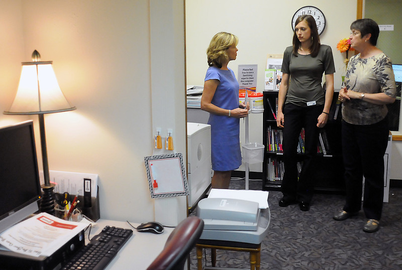 U.S. Rep. Betsy Markey, left, talks to employment specialist Nicole DeTurk and Erma Skadburg, manager of the Loveland branch of the Larimer County Workforce Center, 418 E. 4th St., during Markey's tour of downtown Loveland on Thursday.