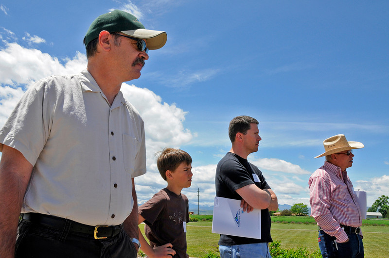 Mark Dowling, left, David, 11, and Michael Coleman and Paul Gleva watch a demonstration of proper watering techniques outside of Northern Water in Berthoud Wednesday, June 2, 2010. Northern Water will provide free clinics on water efficiency every Wednesday in June.