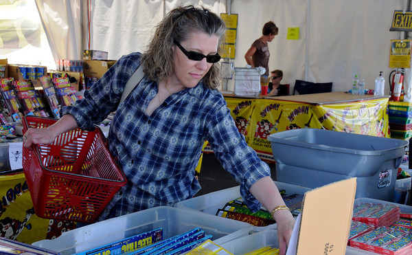 Loveland resident Lisa Ragsdale is stocking up on fireworks at the World Class Fireworks tent at the corner of Eisenhower Boulevard and Taft Avenue. World Class Fireworks is open everyday till the Forth of July from nine till nine.