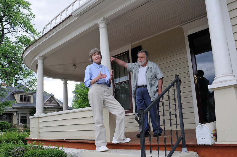 Judy and Kent Hinesley stand on the porch of the home they own at 1268 N. Cleveland Ave. that they hope to have rezoned for commercial use and possibly converted to office use.