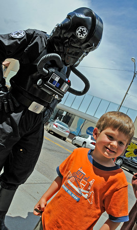 """Loveland resident Reis Howell, 4, laughs after meeting a Tie Pilot before the showing of """"Star Wars Edpisode 4"""" on Wednesday at the Rialto Theater in downtown Loveland. The showing was put on by Friends of the Loveland Public Library to raise  money for the local library."""