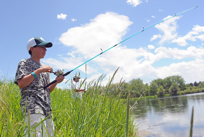 "Greeley residents Manny Araujo, 11, left, and Steve Long  fish for crappie Sunday at Loveland Ready-Mix ponds during a fund-raiser called Hooked On A Cure with proceeds going to The Barlow Foundation, a Northern Colorado-based cancer charity. Brian Spencer, president of The Barlow Foundation, said the group raised about $1000 during the catch-and-release event which he said he hopes to turn  into a yearly fundraiser. The money raised will go to help local families in Northern Colorado who currently have an adult in a battle with cancer. For more information or to donate call Brian at (970) 302-6209 or visit  <a href=""http://www.thebarlowfoundation.org"">http://www.thebarlowfoundation.org</a>."