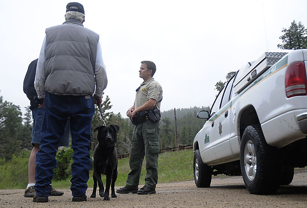 Reporter-Herald/ Chad Spangler<br /> Larimer County Open Space Ranger Steve Gibson checks in with a couple of open space visitors on a recent Saturday afternoon. As a ranger Gibson works to make contact with open space visitors and educate them about the natural resources in the open spaces.