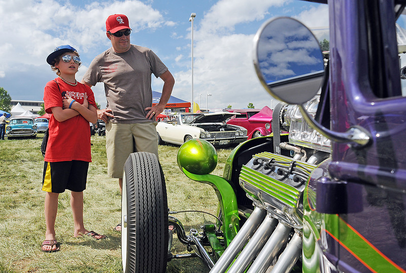 Eleven-year-old Caden Denton, 11, left, and his father, Scott Denton, look at a 1931 Chrysler on display at The Ranch during the Goodguys Colorado Nationals on Saturday. The show continues today from 8 a.m. to 3 p.m. with tickets $18 for ages 13 to adult, $6 for ages 7-12 and free for children 6-and-under accompanied by a paying adult.