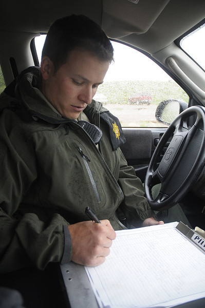 Reporter-Herald/ Chad Spangler<br /> Larimer County Open Space Ranger Steve Gibson fills out a duty log after checking on the trailhead at Devil's Backbone in Loveland on Saturday afternoon.