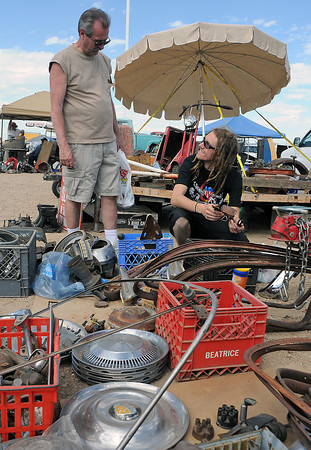 Gary LeValley, left, and Dylan Behan look through some used car parts on display for sale at the Goodguys Colorado Nationals on Saturday, June 5, 2010 at The Ranch.