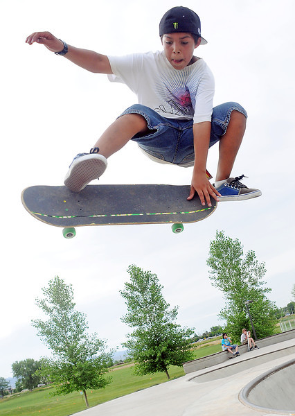 Thirteen-year-old Dylon Hernandez of Loveland flies through the air as he performs a trick while skateboarding with friends Tuesday evening at the Loveland Sports Park.