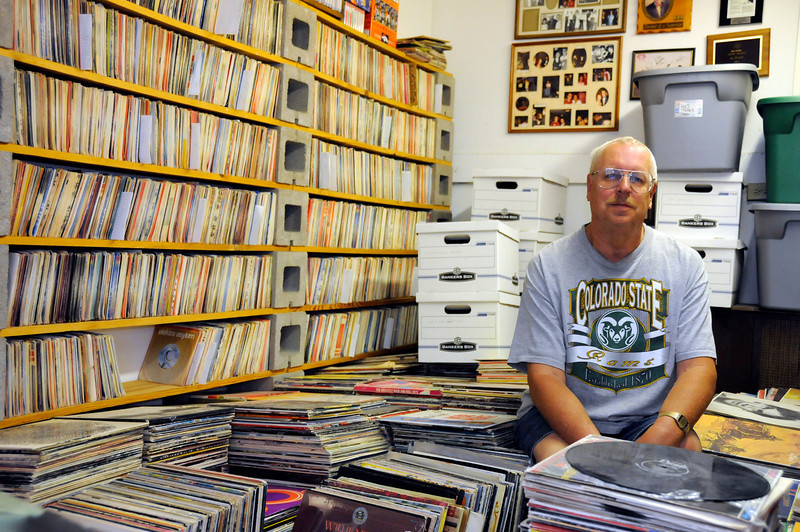 Don Nadow sits surrounded by his collection of albums, tapes, 45s and vinyl records. Don loved music from a yound age and spent 17 years as a DJ.