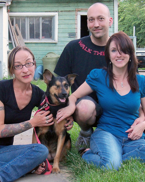 Portia, the mixed-breed dog in front, is surrounded by those who adore her, including Finnegan Dowling, left, who helped rehabilitate her, and Jenny Martin, who adopted her in June 2008, and Martin's boyfriend Sam Bizzell.