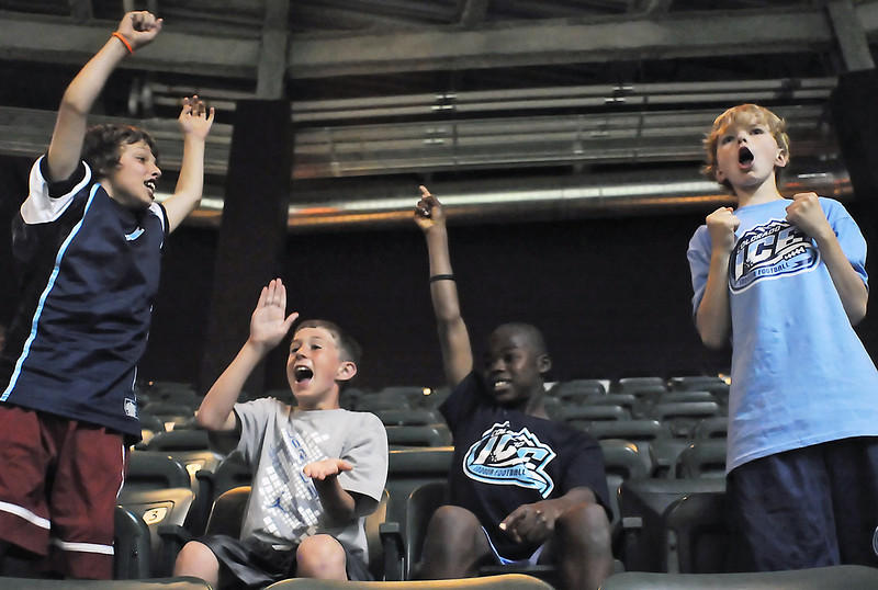 Colorado Ice football fans cheer on the team after a touchdown in the third quarter of a game against the Sioux Falls Storm on Saturday, June 5, 2010 at the Budweiser Events Center. From left are Loveland residents Braxton Bullard, 11, Marcus Carey, 9, and Jordan Kress, 12, and Jacob Isenhour, 12, of Windsor.