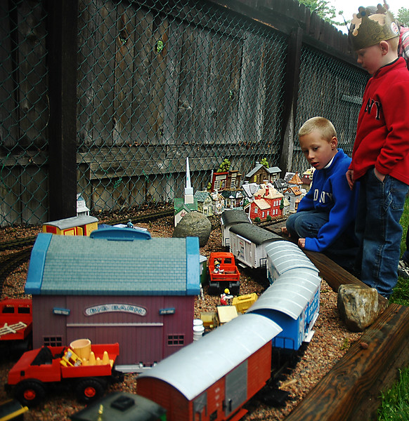 Reporter-Herald/ Chad Spangler<br /> Six-year-old Landon Donaldson, left, and five-year-old brother Aidan, of Estes Park, get a close up view of a working model train during a large-scale garden railroad open house in Loveland on Saturday afternoon. The open house was one of several throughout  Loveland and Ft. Collins benefiting the Food Bank for Larimer County.
