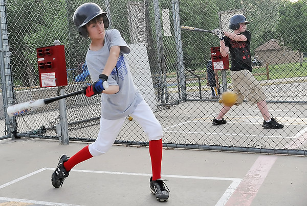 Jarrett Thollot, 12, left, who plays for Tanco and Nick Goldstein, 12, of the Wells Fargo team work on their swings Monday afternoon at the Barnes Complex batting cages. The cages are open Monday through Friday from 12:00 p.m. to 8:30 p.m., weekends with tournaments from 9:00 a.m. to 7:00 p.m. and weekends without tournaments from 12:00 p.m. to 5:00 p.m.