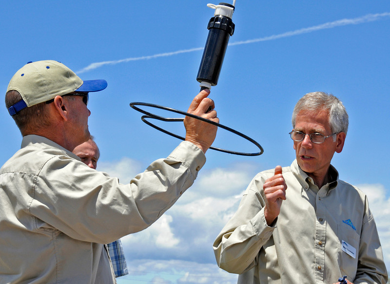 Ron Boyd, left, and Mark Crookston explain the different types of sprinkler heads at Northern Water.