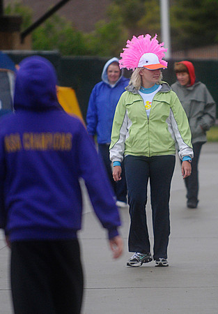 Reporter-Herald/ Chad Spangler<br /> Greeley resident Lauren Rosier walks as part of the Relay for Life at The Ranch on Saturday afternoon. Rosier was walking as a member of Team Duck in support of an aunt who is a cancer survivor. Despite the weather over 1,000 people turned out to help raise money for cancer research.