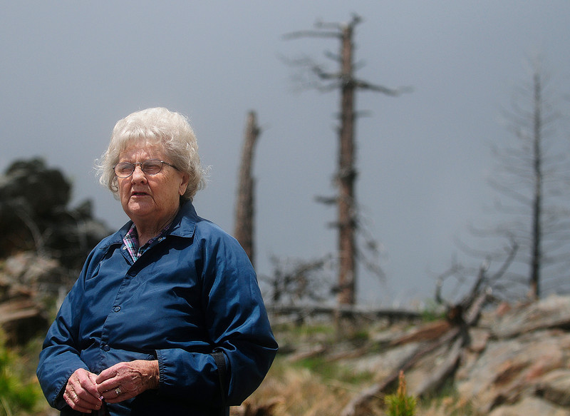 Loveland resident Lorna Miller surveys her land near Drake on a recent spring day. Miller's summer home was one of 22 structures burned in the Bobcat Gulch Wildfire in early June, 2000.