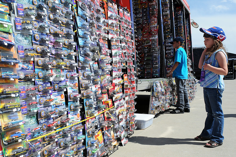 Six-year-old Shelby South, right, and her brother, Camron, 10, try to decide which toy cars to buy at the Burning Rubber Toy Company booth Friday during the Goodguys Colorado Nationals at The Ranch.
