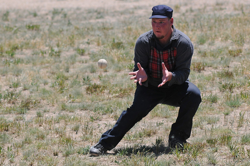 "Bryan ""Colorado"" Phelan fields a ground ball while playing short scout, or shortstop, for the Loveland Heartbreakers during their Vintage Base Ball game against the Territorial All Stars on Sunday at Fairgrounds Park."