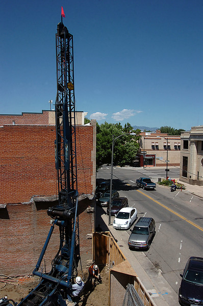 Crews work to drill down about three stories to prepare the foundation at the site of the Rialto Bridge Monday in Loveland. Operating the cason drilling rig is Abe Imes and Steve Benedict, right, both with Elco Drilling. Photo by Jenny Sparks