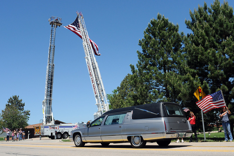 A hearse carrying the body of Chief Warrant Officer Kenneth White enters Resthaven Cemetary on Wednesday afternoon. White, 35, died in a helicopter crash June 5 in Khost province, Afghanistan. He was assigned  to the 1st Battalion, 10th Aviation  Regiment, 10th  Combat Aviation  Brigade, 10th Mountain Division, Fort  Drum, N.Y.