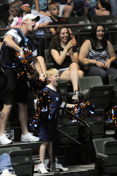 Nine-year-old Dawsyn Winchell, bottom, and his dad, Steve, cheer on the Colorado Ice football team during their game against the Allen Wranglers on Saturday evening at the Budweiser Events Center. The Winchells are from Cheyenne, Wyo. and Steve said their whole family enjoys attending the games together.