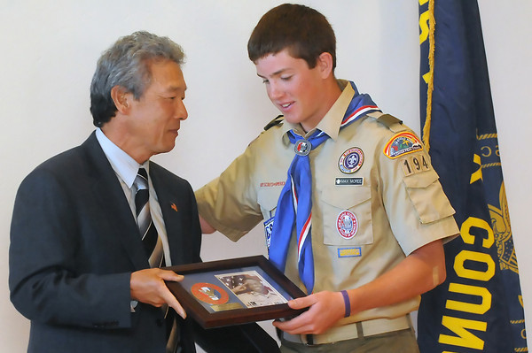 Stan Matsunaka, left, presents Max Moree, 15, with the Eagle Scout of the Year Award on Wednesday at Sylvan Dale Ranch during a fundraising event for the Boy Scouts.