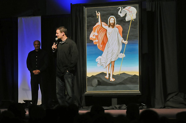 Resurrection Fellowship senior pastor Jonathan Wiggins speaks to members of the church after the unveiling during a service at the Loveland, Colo. church June 18, 2011 of a 5-foot-by-7-foot portrait of Jesus Christ by artist Enrique Chagoya. Chagoya was the artist whose work touched off days of protests and a violent act of vandilism in Loveland last fall.