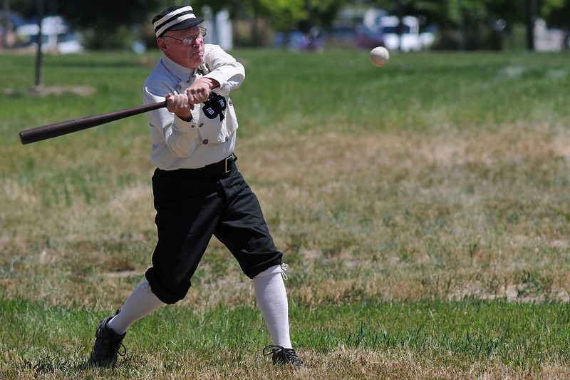 "Eddie ""Fast Eddie"" Phelan eyes a pitch while playing in a Vintage Base Ball game on Sunday at Fairgrounds Park."