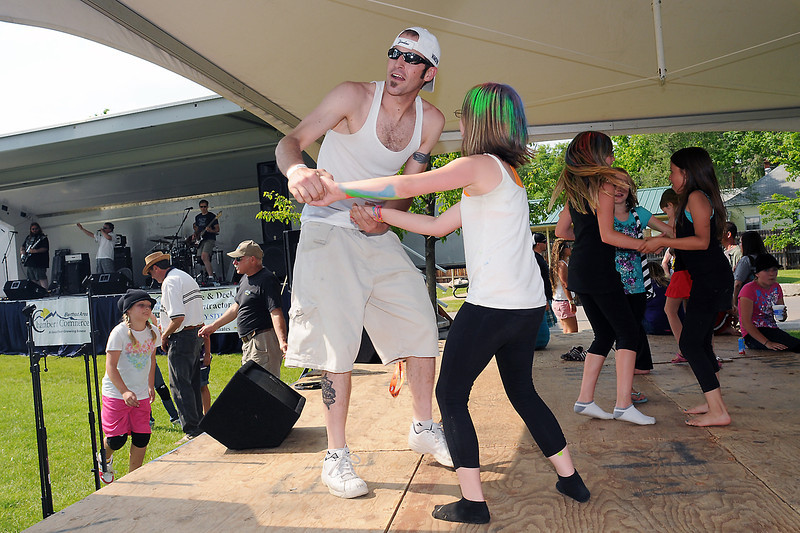 """Front from left, Greg Mastriona dances onstage with his daughter, Madisun, 10, along with Bailey Flores, 10, Kendra Brownell, 7, and Aurelia Miramontes, 10, as the band """"Deep Cover"""" plays a song as part of the Berthoud Day festivities on Saturday at Berthoud Park."""