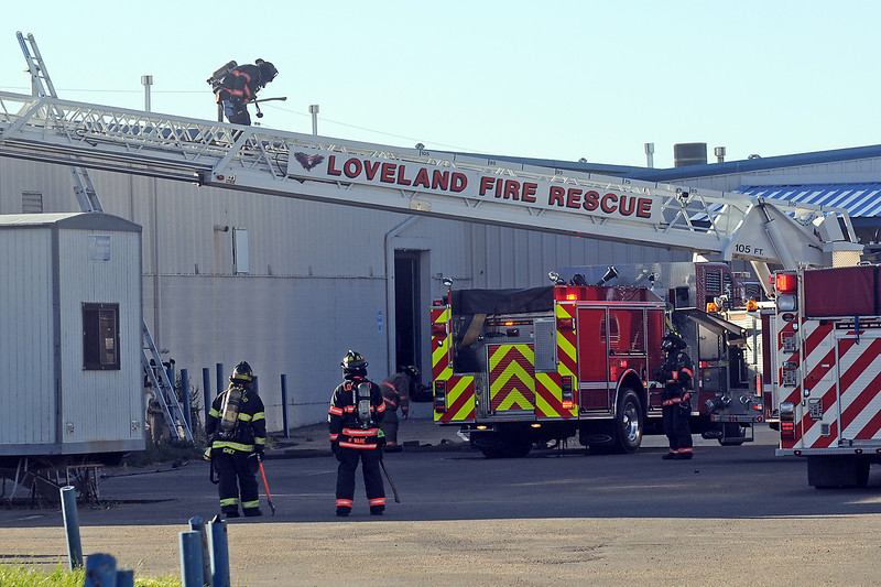 Firefighters from Loveland Fire and Rescue and Berthoud Fire Protection District work the scene of a fire Tuesday evening south of Loveland at 255 S.W. 42nd St.