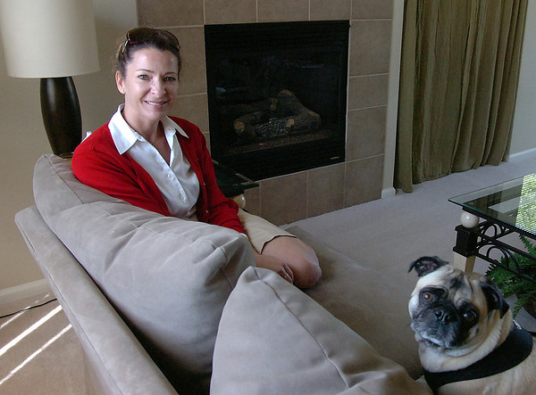 Author Becky Due poses for a photo with her sidekick Shorty Friday at her Loveland home.