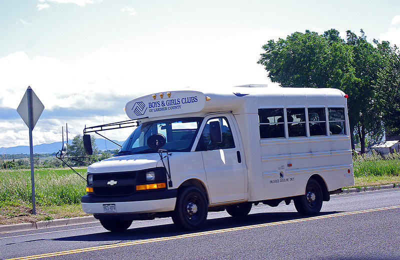 The bus belonging to the Boys and Girls Club of Larimer County zooms down First Street on its way to Greeley for a baseball game recently. Photo by Jeff Stahla