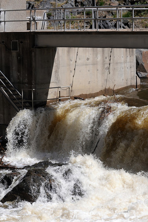 Water flows over the Big Thompson Diversion Dam on Tuesday afternoon in the Big Thompson Canyon west of Loveland.