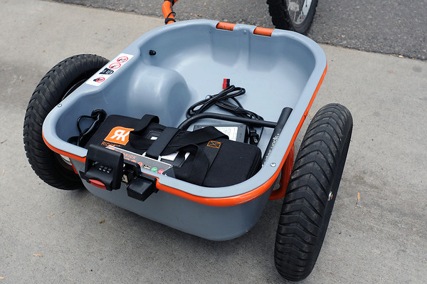 Inside the Ridekick trailer is a rechargable battery that's used to power the electric motor which provides a push to assist the rider in propelling the bike.