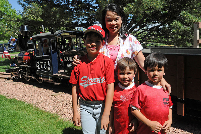 Windsor resident Tobi Snyder, back, poses next to the Buckhorn Northern Railroad train at North Lake Park on June 2, 2011 with her sons, front from left, Logan, 9, Nathan, 5, and Lucas, 7.