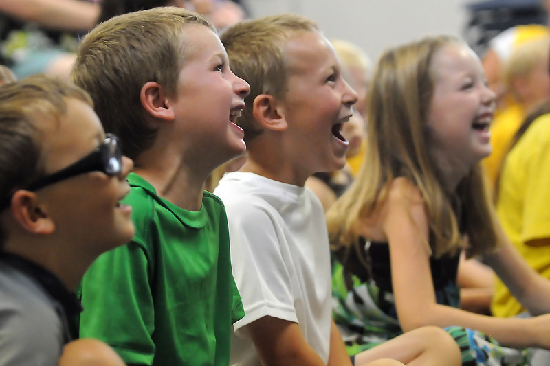 Youngsters laugh aloud while watching Ann Lincoln perform a juggling, magic and comedy show at the Berthoud Community Center on Wednesday, June 29, 2011 as part of the library's program of youth events. From left are Berthoud residents Oliver Baker, 5, Blake Coble, 5, Tanner Coble, 7, and Kenna Lorenzen, 6.