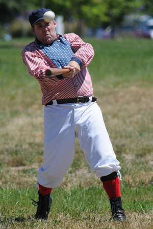 """Traditional All Stars player Bruce """"Old Hoss"""" Foster connects with a pitch during a Vintage Base Ball game on Sunday at Fairgrounds Park."""