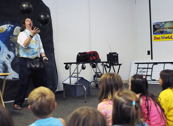 """Ann Lincoln juggles bowling balls during her juggling, magic and comedy show at the Berthoud Community Center on Wednesday, June 29, 2011. Some upcoming Berthoud Community Library summer events will be story time Friday at 10 a.m. for ages 1 to 6, a guitar workshop for teens on July 5 and The World of a Puppet on July 6. For more information visit  <a href=""""http://www.berthoudcommunitylibrary.org"""">http://www.berthoudcommunitylibrary.org</a> or call 532-2757."""