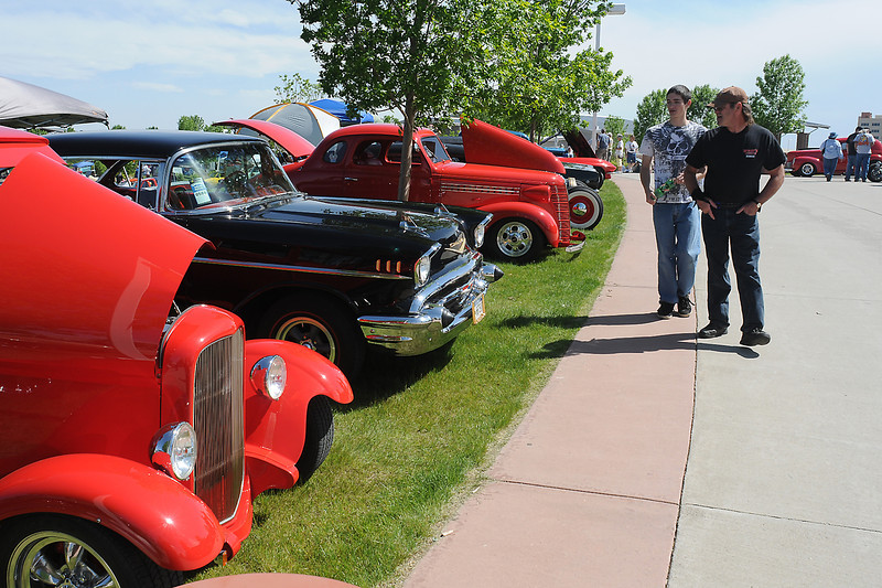 "Brighton resident Rod Begger, right, and his son, John, check out classic cars on display during the Goodguys Colorado Nationals car show on Friday afternoon at The Ranch. The show continues today from 8 a.m. to 5 p.m. and Sunday from 8 a.m. to 3 p.m. and features more than 2,000 hot rods, cars and trucks as well a vendors, exhibitors and a swap meet. Visit  <a href=""http://www.coloradonats.com"">http://www.coloradonats.com</a> for more information."