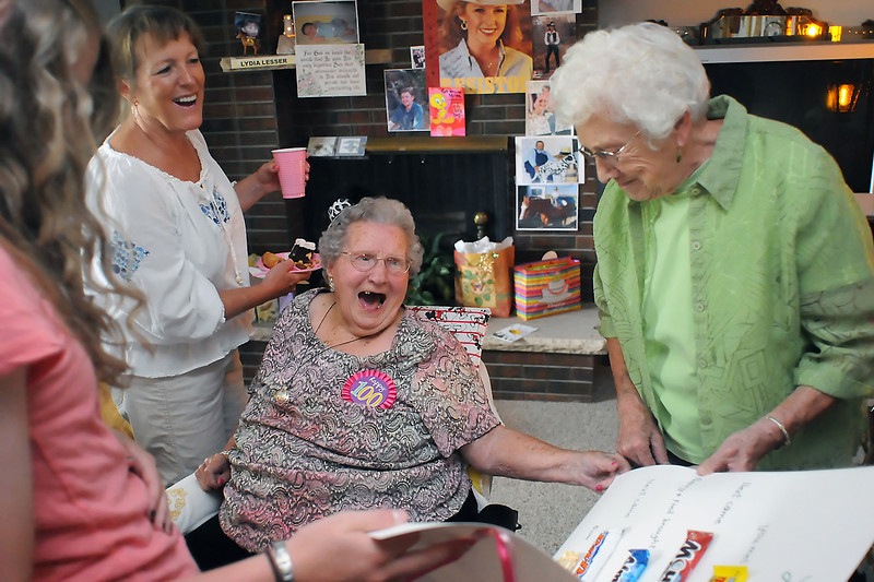 Lydia Lesser, center, who turns 100 on Monday, shares a laugh with guests during a birthday party for her on Saturday at her Loveland home. From left are great-granddaughter Mallory Leach, 16, Bonita Ekx, Lesser, and Arlene Ream.