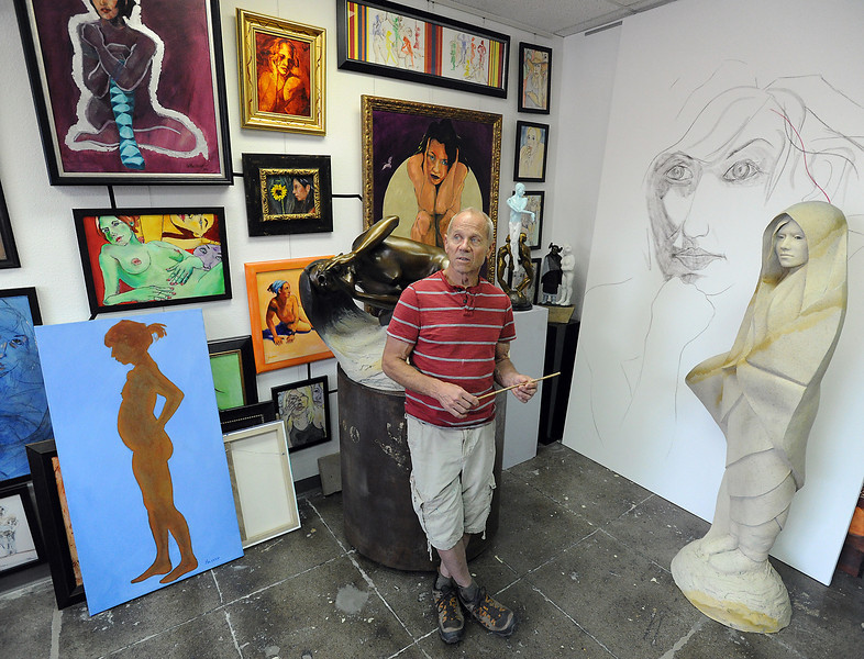 Loveland artist Denny Heskew talks about his work on Tuesday May 28, 2013 while standing in his studio at Artworks Loveland in downtown. Heskew has an art exhibit that starts on June 14 at Artworks Loveland.