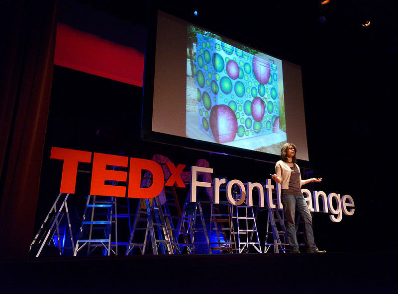 "Josie Plaut speaks at the TedX Front Range event Friday, May 31, 2013 at the Rialto Theater Center in downtown Loveland. She talked about ""Our path to an infinite future"" saying how we should use solutions to problems that address more thatn one thing. She used an example about having artist paint transormer boxes instead of having to spend money painting over graffiti all the time."