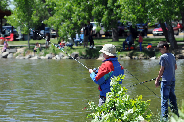 Eleven-year-old Sean Kouma, left, and T.J. Manley, 12, fish along with other youngsters during the Loveland Fishing Derby on Saturday, June 1, 2013 at North Lake Park.