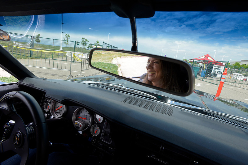 "Deb McGilton's refelction is seen in her rear-view mirror Friday June 7, 2013 as she waits in line to race her 1969 Chevy Camaro RS in the Auto Cross event during the Goodguys Car Show at The Ranch in Loveland. McGilton and her husband, Tim, traveled from their home Wake Forest, North Carolina to come to the show and race in the Auto Cross event. Talking about racing through the timed course McGilton said ""I used to ride along with my husband and whoever else would let me. My husband would ask if I was having fun and I told him I'd be having more fun if I had my own car and I could drive."" Her husband sold two of his cars to buy her the 69' Camaro last October."