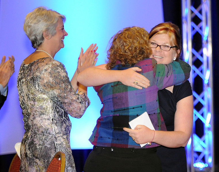 Beth Hicks, right, gets a hug from Mary Carraher Thursday June 6, 2013 after speaking at the 11th annual State of the Community presented by Untied Way of Larimer County at the Embassy Suites Hotel & Conference Center in Loveland. Hicks talked about her success story with the help of Project Self-Sufficiency and Carraher was honored as the Community Collaborator of the Year.