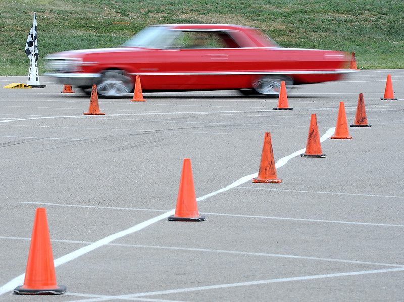 Curt Schnitzer of Cheyenne, Wyoming blazes past cones Friday June 7, 2013 in his 1963 Chevy Impala during the Goodguys Car Show Auto Cross event at The Ranch in Loveland.