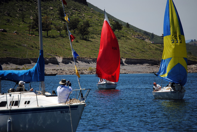 Sailboats make it to the finish line of the 54th annual Carter Lake Sailing Open Regatta, on Sunday June 2, 2013. As the boats get to the finish line one of the club members on the finish line boat marks their individual times to later determine who the winner is.