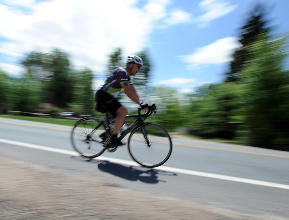 """Peter Sahd of Loveland rides his bycycle Tuesday June 4, 2013 on Eisenhower Boulevard west of Morning Drive. Sahd said """"I ride as often as I possibly can."""""""